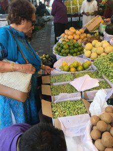 Uma trying some grapes!